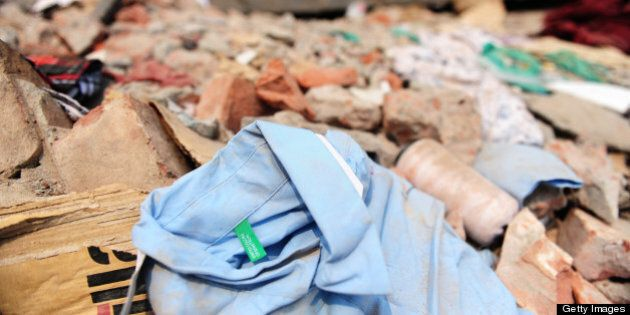 A shirt with a Benetton label lies in the rubble three days after a Bangladeshi garment eight-storey...