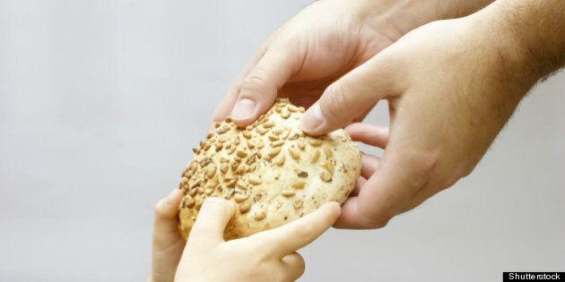 sharing bread. man giving bread