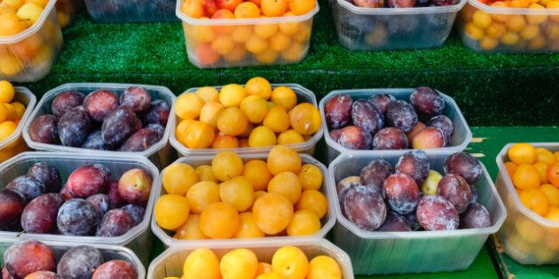 yellow and purple plums on...