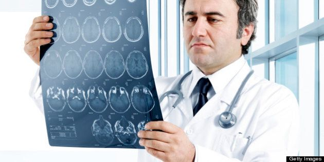 Medical doctor analyzing a CT scan