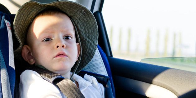 cute little boy passenger in a...