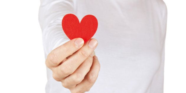woman gives a fabric heart to...