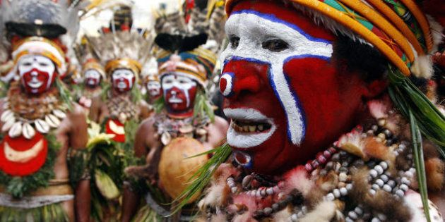 Goroka, PAPUA NEW GUINEA: Kuna women from Anglimp in the Western Highlands arrive at the 50th Goroka...