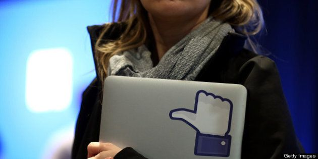 MENLO PARK, CA - APRIL 04: A Facebook employee holds a laptop with a 'like' sticker on it during an event...