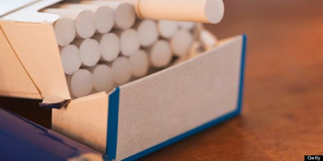 Close up of open cigarette pack and
