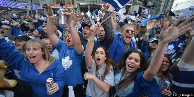 TORONTO, ON - MAY 8: Toronto Maple Leaf fans who have gathered outside the Air Canada Centre cheer while...