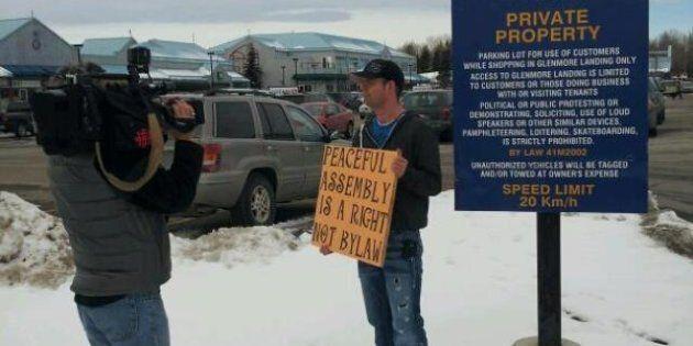 Sign Bans Protest Outside Stephen Harper's Calgary