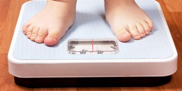 Closeup view of scales on a floor and kids