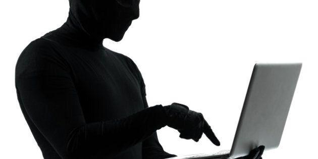 thief criminal computer hacker