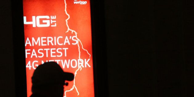NEW YORK, NY - JUNE 07: People walk by a Verizon advertisement on June 7, 2013 in New York City. In a...
