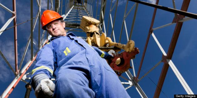 A royalty free image from the oil industry of an oil worker at a oil