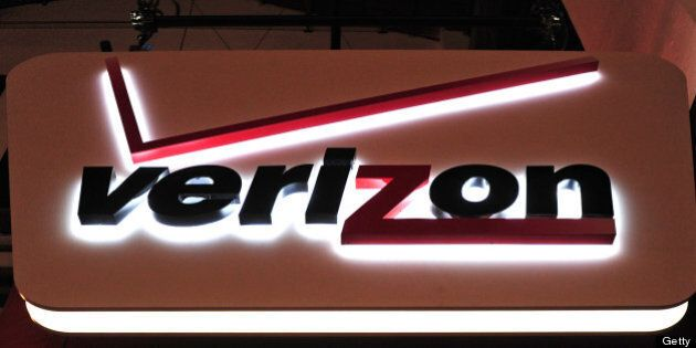 A Verizon Communications Inc. logo is seen on display at the Mobile World Congress in Barcelona, Spain,...