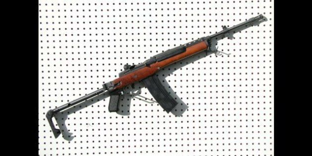 Description 1 Ruger Mini-14/F30GB semi-automatic rifle (pictured with folding stock open) ... completely...