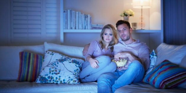 Couple watching television on