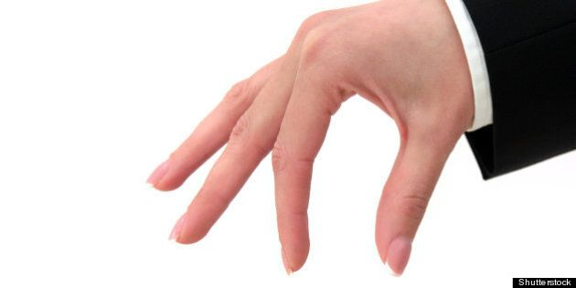 pinching hand sign isolated