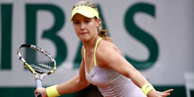 Canada's Eugenie Bouchard hits a forehand shot to Russia's Maria Sharapova during a French tennis Open...