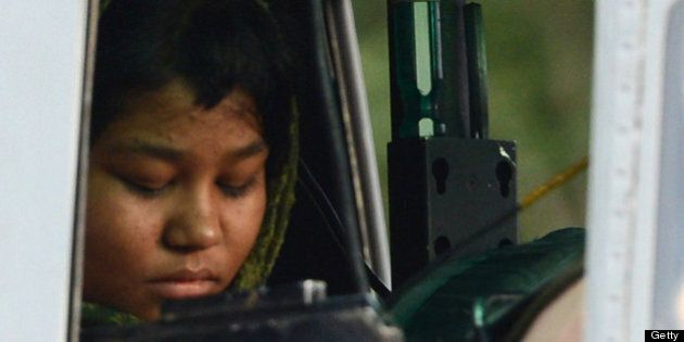 Rimsha Masih, a Christian girl accused of blasphemy sits in helicopter after her release from jail in...
