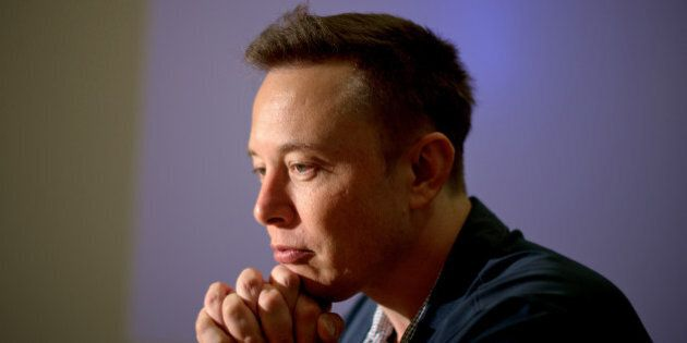 Elon Musk, co-founder and chief executive officer of Tesla Motors Inc., pauses during an interview at...