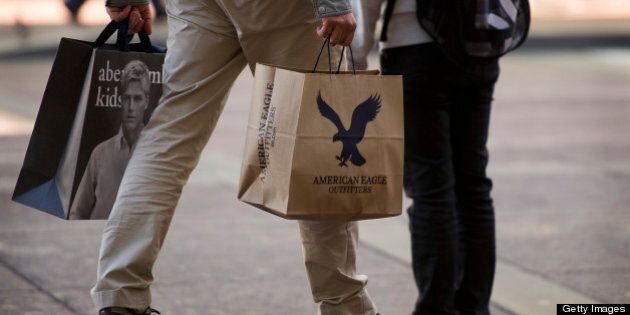 A shopper carries an American Eagle Outfitters Inc. bag and an Abercrombie & Fitch Co. bag in San Francisco,...