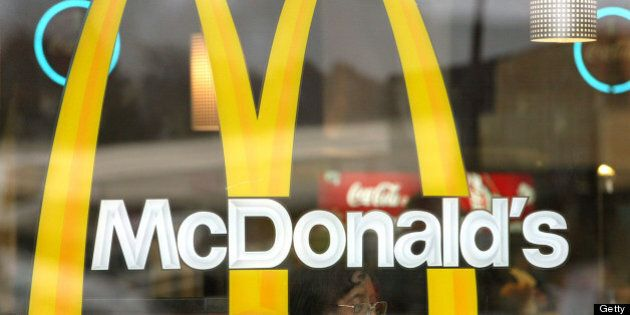 WILLOWBROOK, IL - NOVEMBER 11: (FILE PHOTO) A patron is seen through a window displaying McDonald's golden...