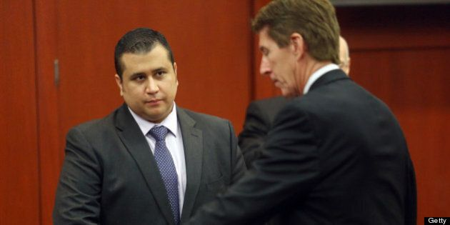 SANFORD, FL - JULY 03: George Zimmerman, left, and Defense attorney Mark O'Mara chat during an early...