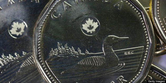 Canadian dollar coins, known as a 'Loonies', are arranged for a photograph in Toronto, Ontario, Canada,...