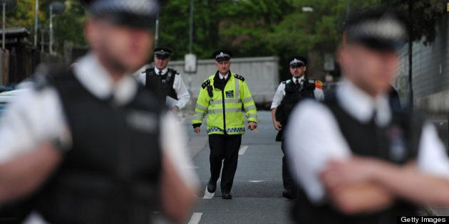 Police officers cordon off a road area in Woolwich, east London, on May 22, 2013, following an incident...