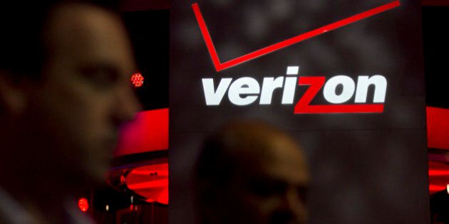 The Verizon Communications Inc. logo is seen at the International Consumer Electronics Show (CES) in...