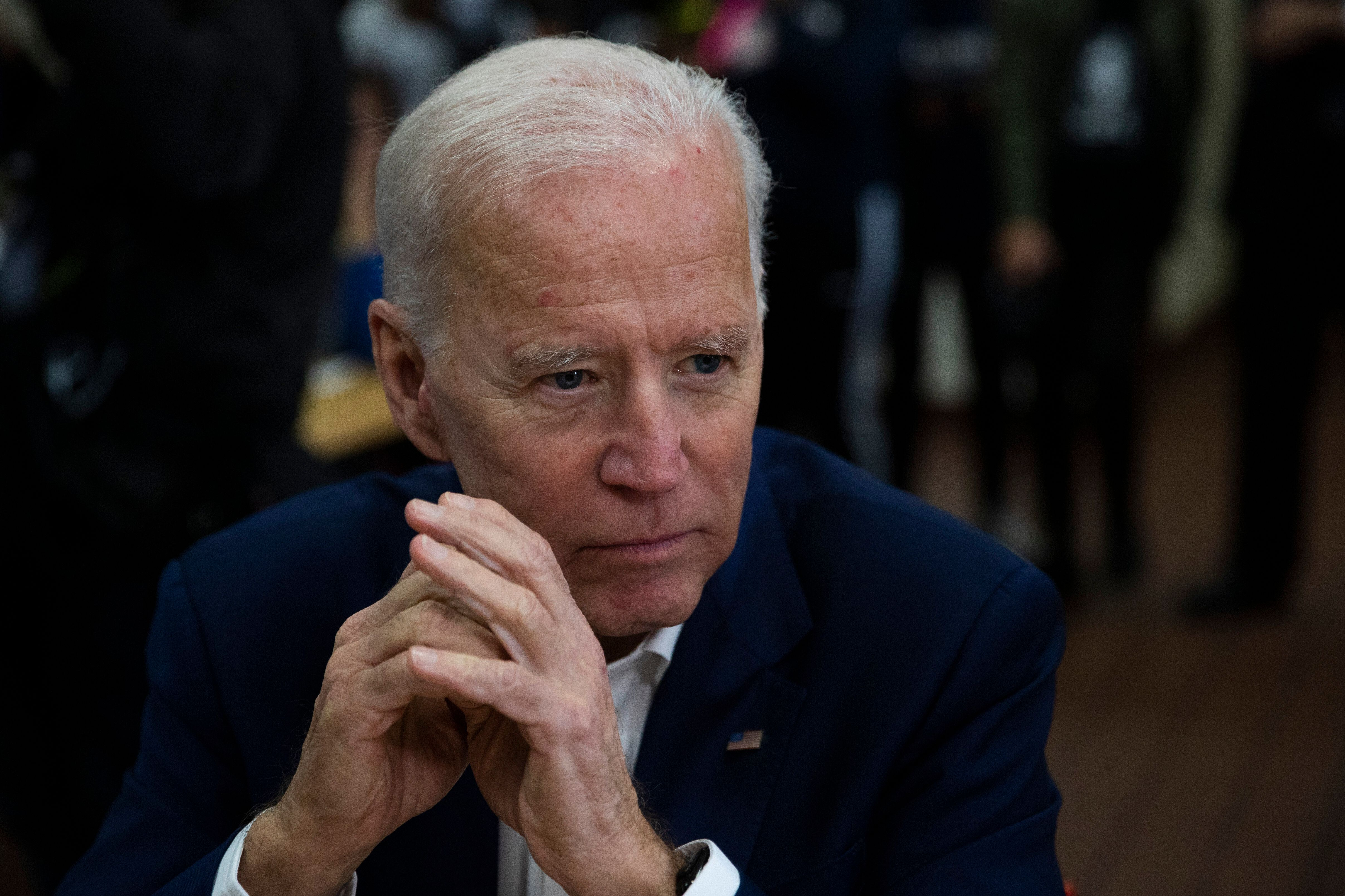 Former Vice President Joe Biden listens to voter in Los Angeles on Wednesday. The vice president is reportedly preparing a cl