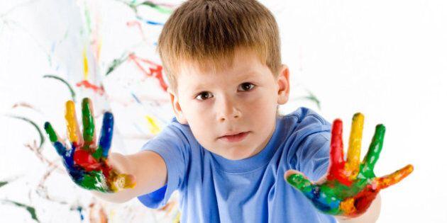 little boy draws bright