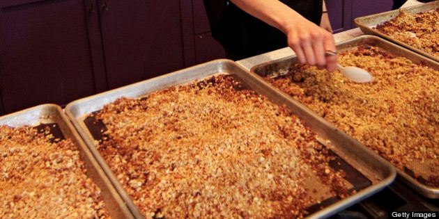Chef Dani Fontaine spreads out cannabis-infused, gluten-free trail mix during a cannabis cooking class...