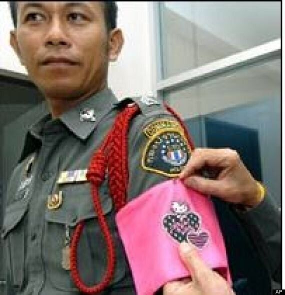 Thailand Police Get Hello Kitty Armbands As Badge Of