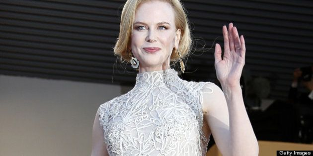 Australian actress and member of the Feature Film Jury Nicole Kidman waves on May 23, 2013 as she arrives...