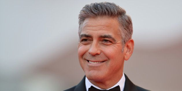 US actor George Clooney arrives for the opening ceremony of the 70th Venice Film Festival and the screening...