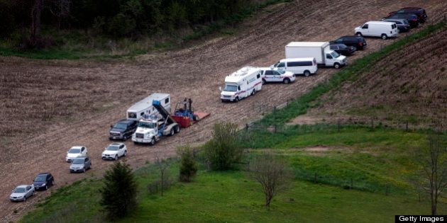 NORTH DUMFRIES, ON - MAY 14: Vehicles near the farm  where police are  investigating the death of Tim Bosma at 2548 Roseville Rd. in North Dumfries Township. Bosma, the Ancaster man who disappeared more than a week ago after leaving his home with men who came to test drive his truck, has been found dead, Hamilton police announced Tuesday morning.        (Andrew Francis Wallace/Toronto Star via Getty Images)