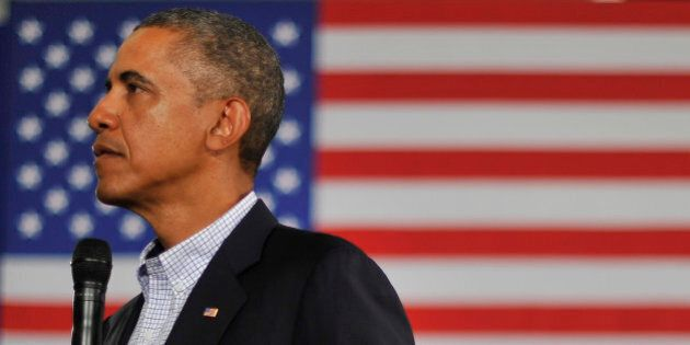 US President Barack Obama listens to a question during a town hall meeting at Binghamton University,...
