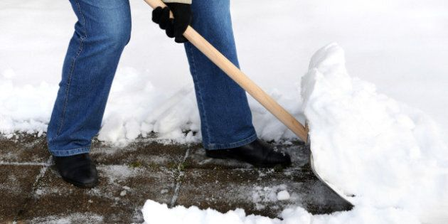 Woman is shovelling
