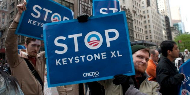 Environmental activists march through midtown protesting the proposed Keystone XL pipeline, May 13, 2013...
