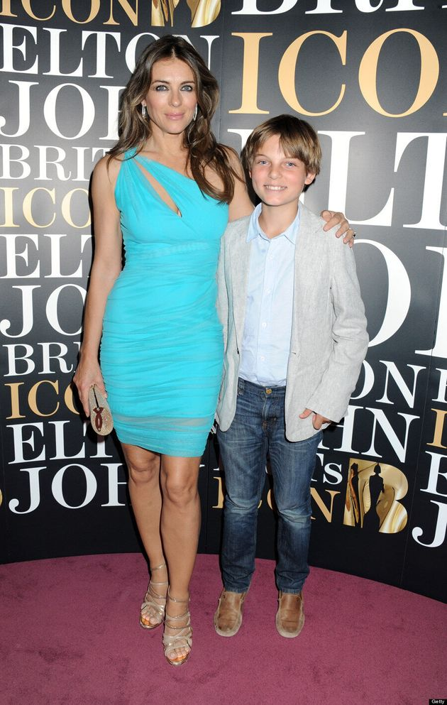 Elizabeth Hurley Steps Out In Versace With A Dapper New