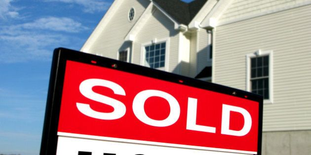 real estate lawn sign sold...