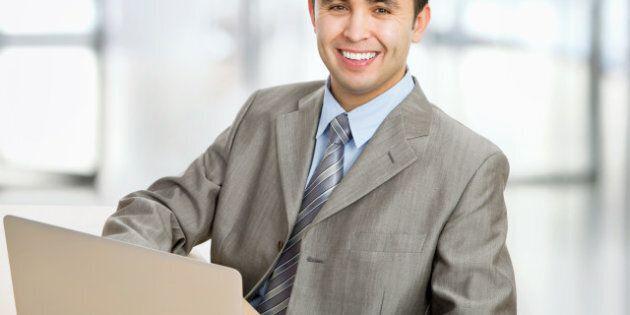 happy business man sitting