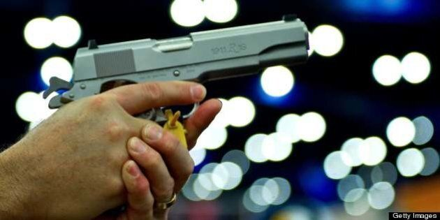 A convention goer handles a Ruger 1911 model semi-automatic pistol during the142nd annual National Rifle...