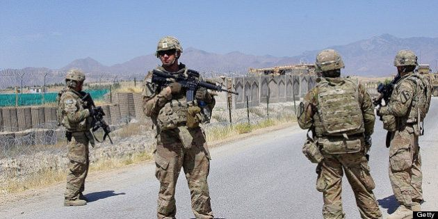 US soldiers, part of the NATO-led International Security Assistance Force (ISAF), stand guard on the...