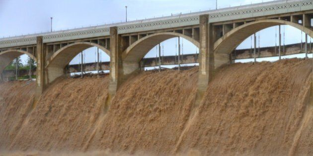 [UNVERIFIED CONTENT] Glenmore Dam is overwhelmed by flood waters and has reached levels never before...