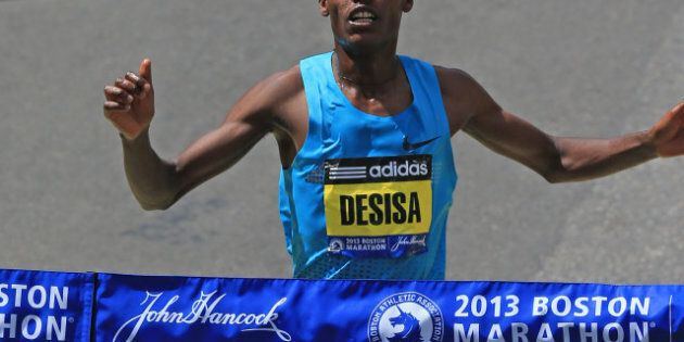 BOSTON - APRIL 15: Lelisa Desisa, 23, of Ethiopia, crosses the finish line to win the men's race at the...