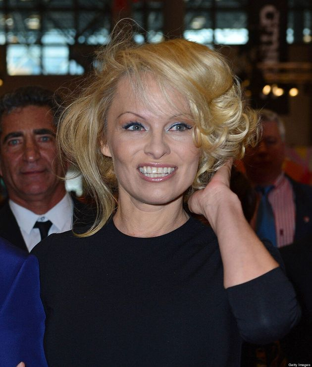 Pamela Anderson Wears Modest Dress: 'Baywatch' Beauty Poses At International Beauty Show