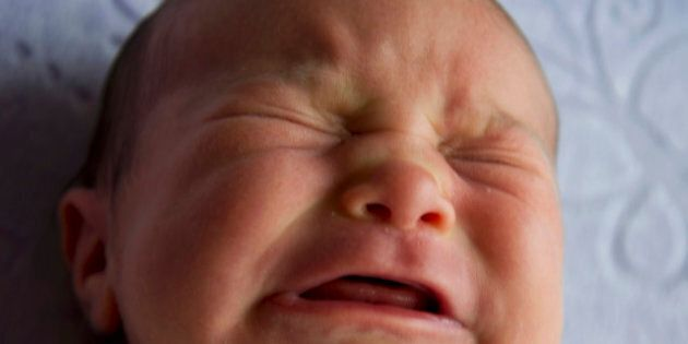 Portraits of a newborn baby girl crying