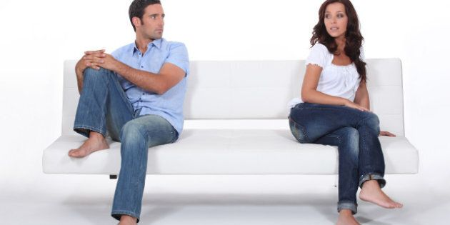 couple sitting apart in