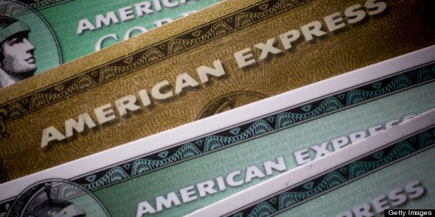 American Express Co. credit cards are arranged for a photograph in New York, U.S., on Monday, April 15,...