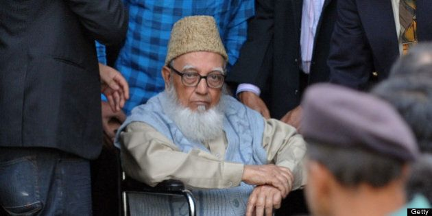 Former head of opposition Jamaat-e-Islami party Ghulam Azam (C) escorted by security personnel and lawyers...